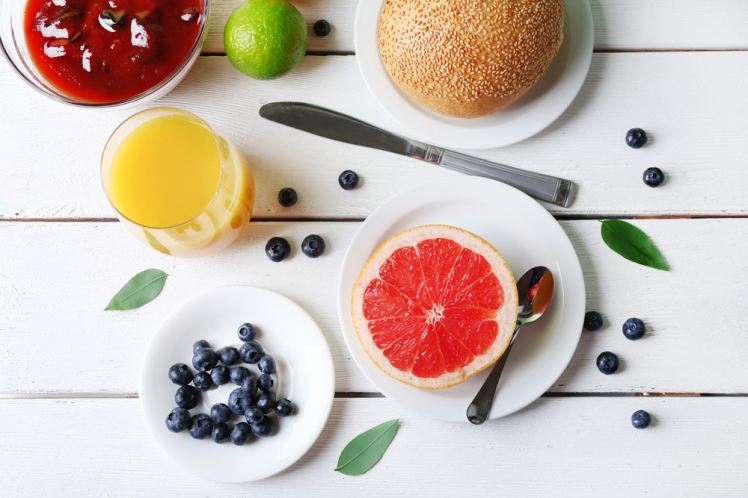 Healthy breakfast with fruits and berries on table close up