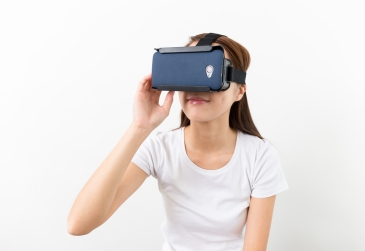 Woman hand touch on the virtual reality headset